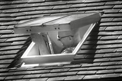 Working man in roof skylight hatch Stock Images