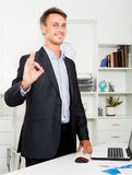 Working man satisfied with agreement in company office Royalty Free Stock Photos