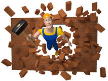 Working man with a sledgehammer destroys a brick wall. Working man in an orange helmet in yellow T-shirt, in blue overalls, yellow boots holding a sledgehammer Royalty Free Stock Image