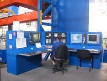 Working specialist male operator works at the control panel at the plant in the shop stock photo