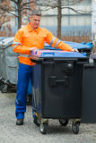 Working Man Standing Near Dustbin On Street Royalty Free Stock Photography
