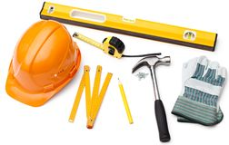 Working materials, stuff. Hard hat, pencil, line, hammer, nails, gloves, tape measure and level, isolated on white Stock Image