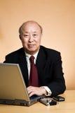 Working mature businessman Stock Photography