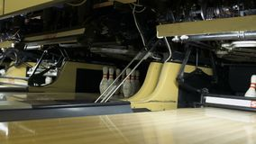 Mechanism of bowling machine. Working mechanism of bowling machine. The equipment takes away the bowling pins and places a new pins stock footage