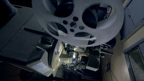 Working mechanism of an old vintage film projector. Dolly shot. stock video footage