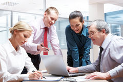Working meeting. Portrait of busy partners working together in office Royalty Free Stock Image
