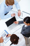 Working at meeting. Above view of business partners working at meeting royalty free stock photo
