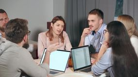 Working meeting of young creative employees of company, men and women. Business session of directors of company departments in office. Young men and women are stock footage