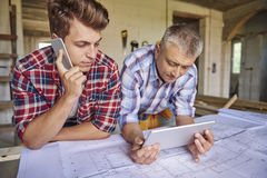 Working men. Carpenters are getting from A to B point Royalty Free Stock Image