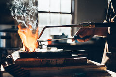 Working the metal in a crucible Royalty Free Stock Photo