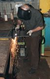 Working at a metal fabrication shop Stock Images