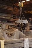 Working metal scrap loading machine in action. Workingmetal scrap loading machine in action loading old rusty metal rubbish inside a factory Stock Photos