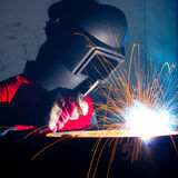 Working metal welder with sparks Stock Photo