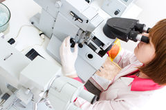 Working with microscope in lab Royalty Free Stock Images