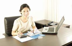 A working miss staff in office. A miss staff is check account records in office Royalty Free Stock Images