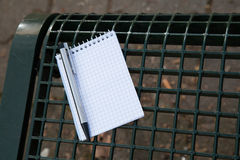 Working mobile with a black pen and note pad Stock Image