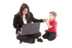 Working Mom Giving Son Sandwich Royalty Free Stock Photo