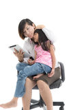 Working mother and daughter with tablet Stock Photography