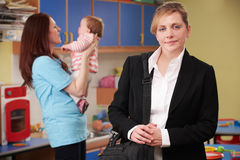Working Mother Dropping Child Off At Nursery Royalty Free Stock Image