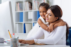 Working mother Stock Images