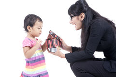 Working Mum gives a Present to her Daughter. Asian girl receiving a present from her working mum Royalty Free Stock Photo