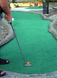 Working On My Putt. A man about to putt a mini-golf ball Stock Photos