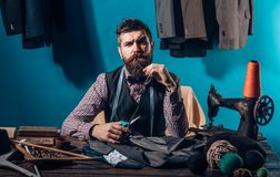 Working on new collection. Bearded man tailor sewing jacket. suit store and fashion showroom. business dress code stock image