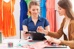 Working on new fashion look together. Stock Image