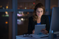 Working in night office Stock Images