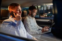 Working night-business man use smartphone in the car Royalty Free Stock Photos