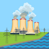 Working nuclear power plant near tower set along flowing river Royalty Free Stock Image