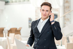 Working in the office. Confident and successful businessman stan Royalty Free Stock Photo