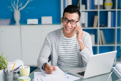 Working at office desk Royalty Free Stock Photo