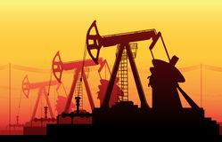 Working Oil Pumps and Drilling Rig Stock Images
