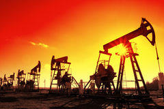 Working oil pumps silhouette in row Stock Photography
