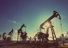 Working oil pumps silhouette - vintage retro style Stock Photos