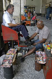 Working old shoeshiner, city Recife, Brazil Stock Photography