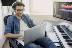 Free Working On A Laptop. Busy Guy. Multitasking Concept. DJ In Broadcasting Studio. Music Producer Is Composing A Song On Stock Photography - 178932322