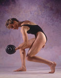Working Out. Girl working out with barbells Stock Images