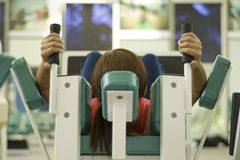 Working Out. A female works out in a gym. Picture has shallow depth of field Stock Photo