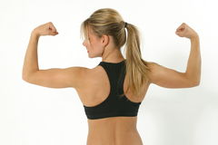 Working out 8. Young woman exercising Royalty Free Stock Photography