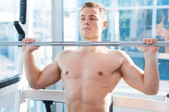 Working out on bench press. Stock Images