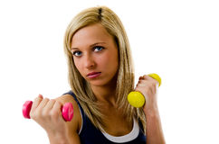 Working out with dumbbell. Blonde pretty fitness girl working out with dumbbells Stock Photo