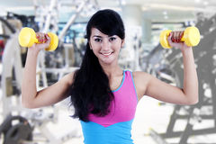 Working out with dumbbell Royalty Free Stock Image