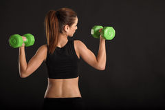 Working out with dumbbells Royalty Free Stock Images