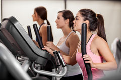 Working out in elliptical trainer Royalty Free Stock Photo