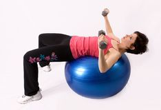Working out on an exercise ball. Beautiful young brunette working out on an exercise ball (not isolated Stock Photos