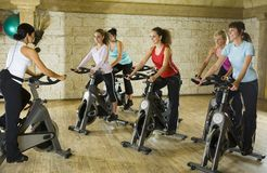 Working out on exercising bikes royalty free stock photos
