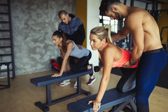 Working out in fitness center. With trainer supervision Stock Photos