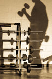 Working out hard. Image of a shadow of an athlete working out Royalty Free Stock Photo